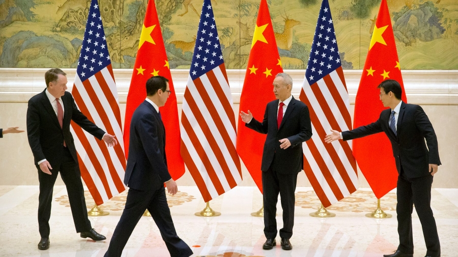 Mandatory Credit: Photo by MARK SCHIEFELBEIN/POOL/EPA-EFE/REX (10104491d) Aides gesture as United States Trade Representative Robert Lighthizer (L), Chinese Vice Premier and lead trade negotiator Liu He (2-R) and United States Secretary of the Treasury Steven Mnuchin (2-L) line up for a photo before the opening session of trade negotiations at the Diaoyutai State Guesthouse in Beijing, China, 14 February 2019. China and USA trade talks in Beijing - 14 Feb 2019