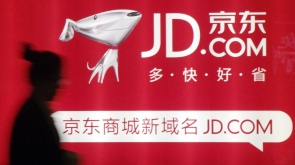 A woman walks past a advertisement board of Jingdong Mall (JD.com) in Nanjing, Jiangsu province in this May 7, 2013 file photo. JD.com, China's second-largest e-commerce site, is set to exceed 100 billion yuan ($16.47 billion) in annual sales for the first time in a market that has drawn investment from global retailing names such as Amazon and Wal-Mart. REUTERS/China Daily/Files (CHINA - Tags: BUSINESS SCIENCE TECHNOLOGY) CHINA OUT. NO COMMERCIAL OR EDITORIAL SALES IN CHINA